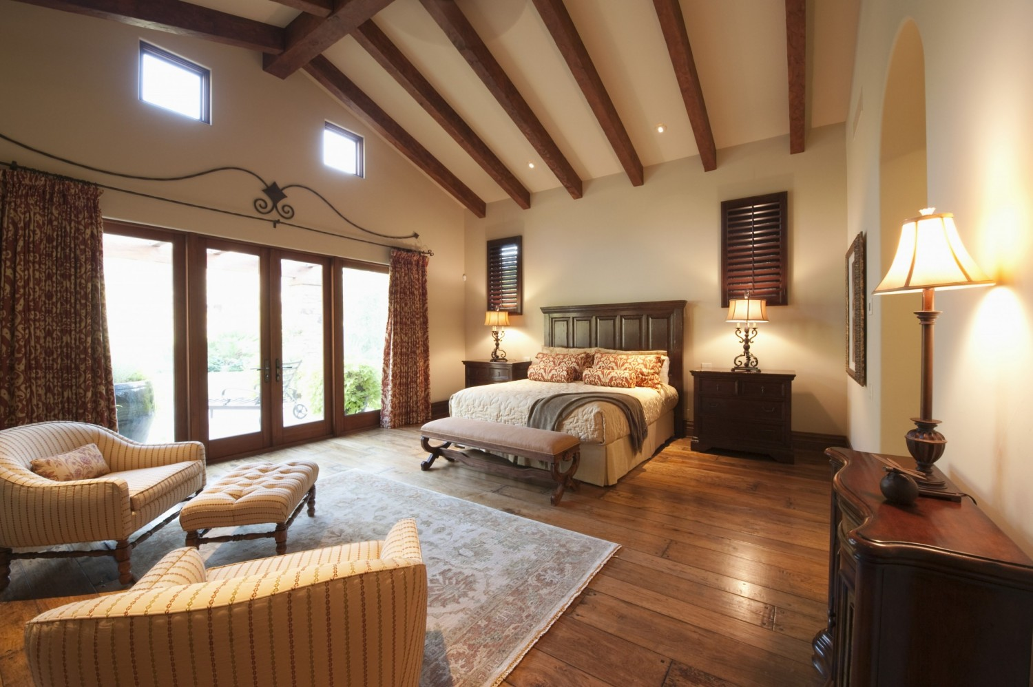 Spacious bedroom with beamed wooden ceiling